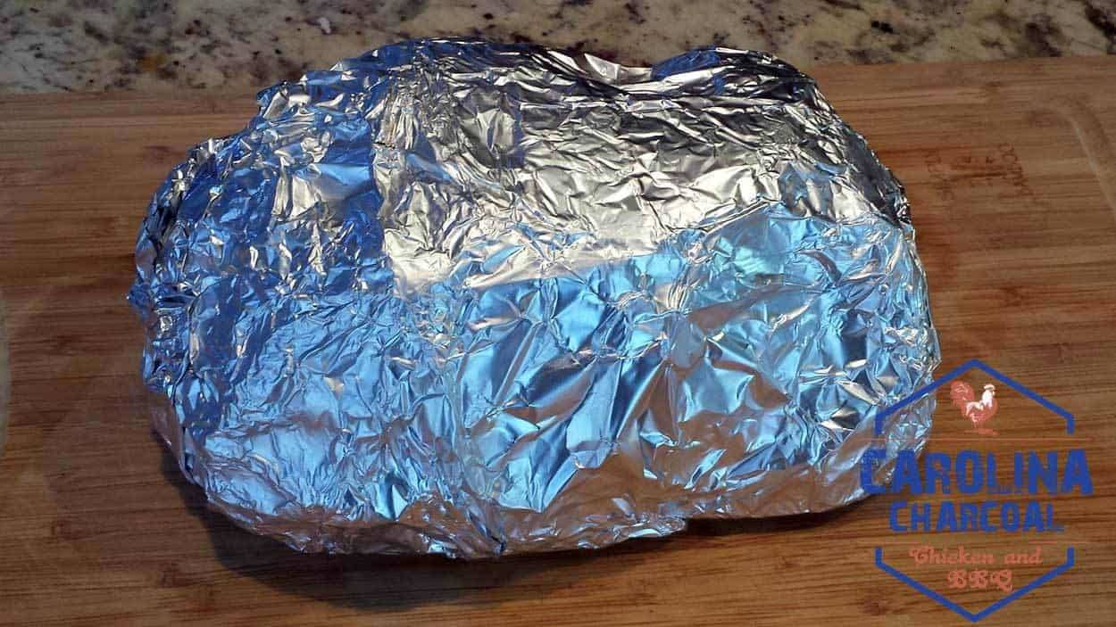 Bone-in Boston Butt wrapped in foil