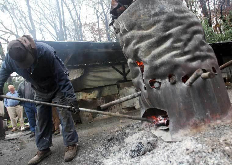 Gathering embers from the burn barrel at Scott's BBQ Hemingway