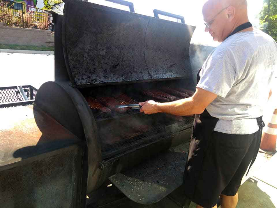 Kenny Wells Working Grill at PK BBQ.