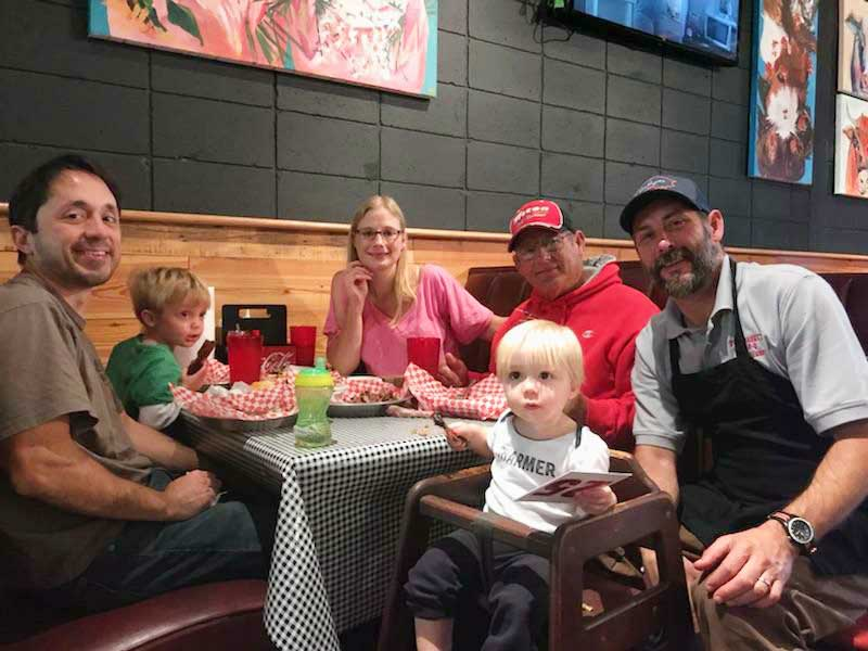 Chris Reeder greeting a Family dining at Fat Daddy's
