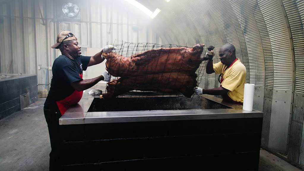 Rodney Scott flipping whole hog on pit