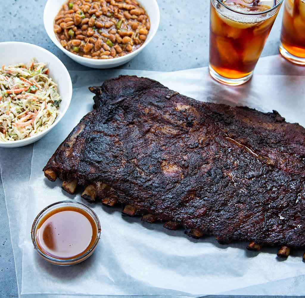 Rodney Scott's BBQ ribs with sides and drinks
