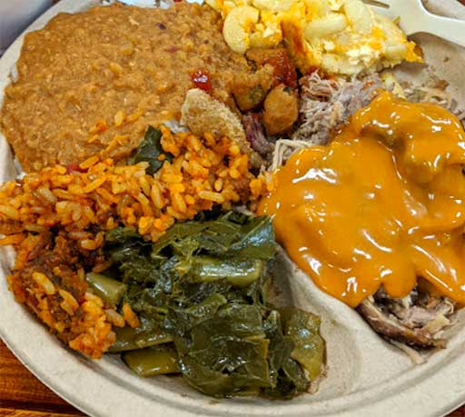 BBQ Plate with barbecue, collards, hash, and other sides at Dukes on James Island