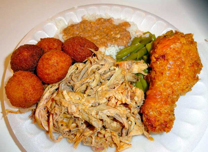 Pulled Pork, fried chicken, hush puppies, green beans and hash and rice plate.