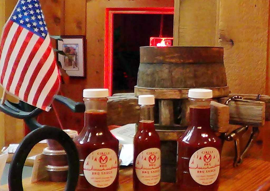 Bottles of Circle M's Vinegar-Based BBQ Sauce