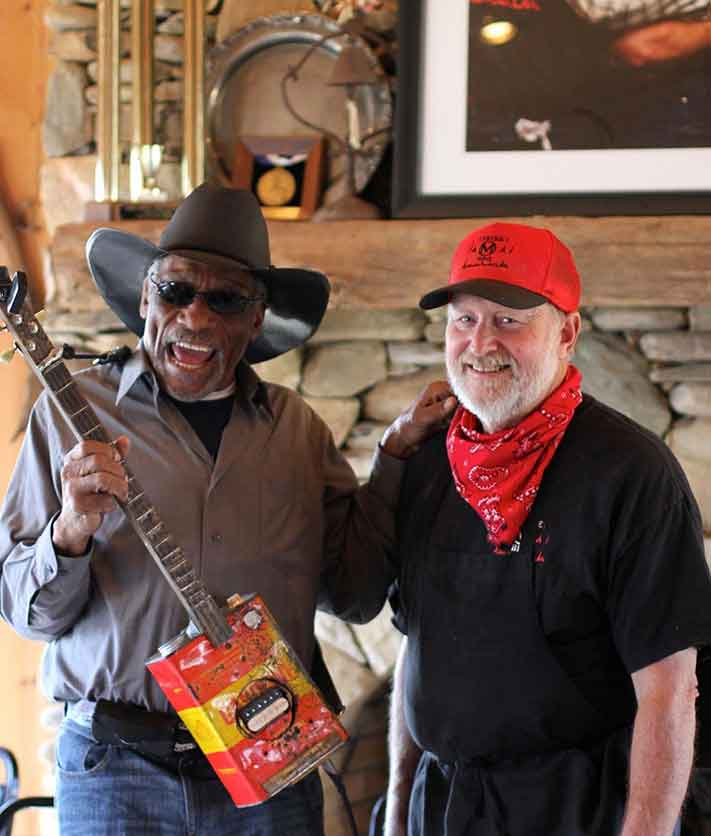 Musician Mac Arnold with Circle M BBQ owner Marion Martin