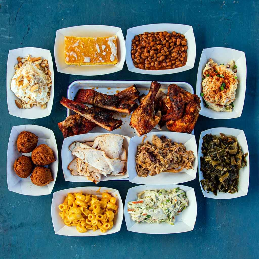 Food trays with each of the food items served at Rodney Scott's BBQ.