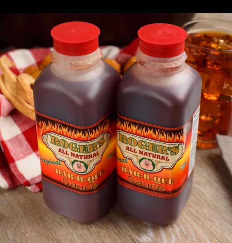 Two bottles of the famous vinegar and pepper sauce from Roger's BBQ
