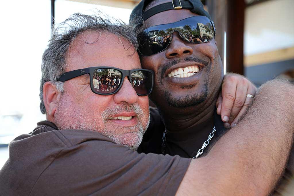 Nick Pihakis and Rodney Scott hugging.