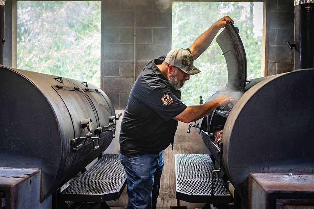 Owner Anthony DiBernardo working the pits at Swig and Swine