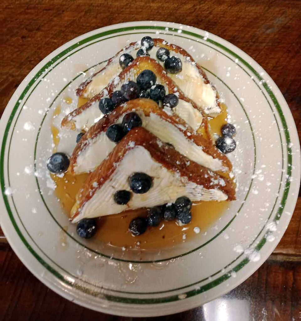 French toast covered in blueberries and syrup from the breakfast menu