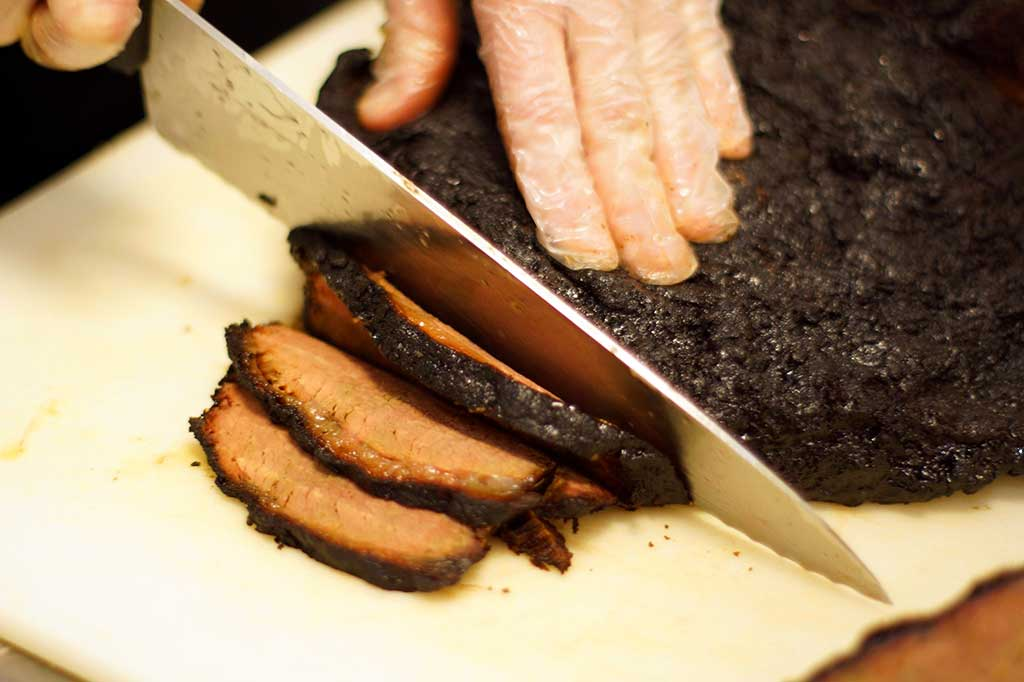 Close of up brisket being cut at Sweet Caroline's in McConnells.