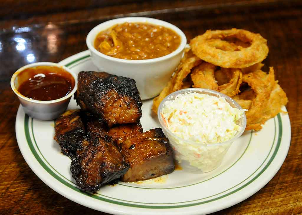 Burnt ends with sauce, baked beans, onion rings and slaw from Sweet Carolines in McConnells.
