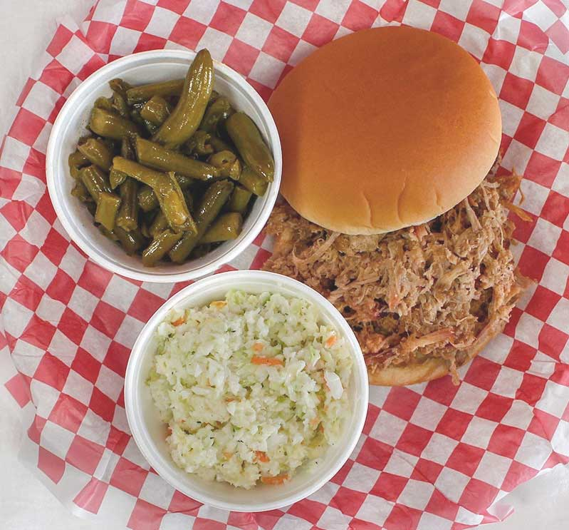 Carolina Barbecue and More BBQ Sandwich Plate with green beans and coleslaw.