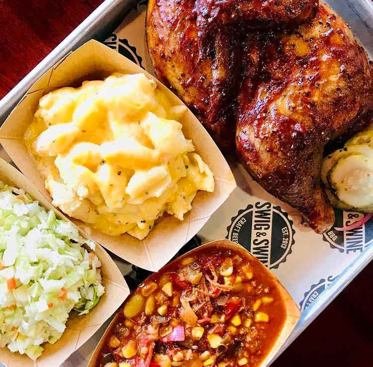 Half chicken in red sauce with 3 sides: slaw, Mac and cheese, Brunswick Stew.