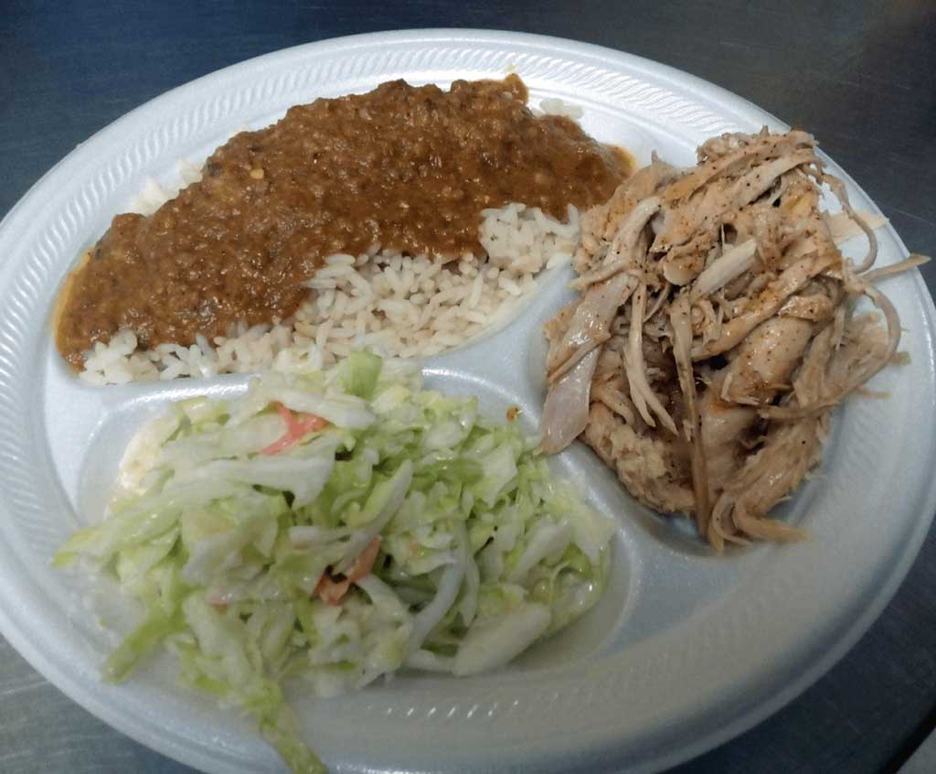 Sugar Hill BBQ plate with hash and rice, coleslaw, and pulled pork.